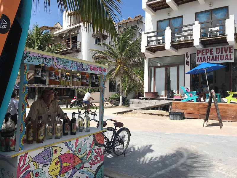 Vendors, dive shops and boutiques and restaurants line Mahahual's pedestrian malecon (boardwalk).