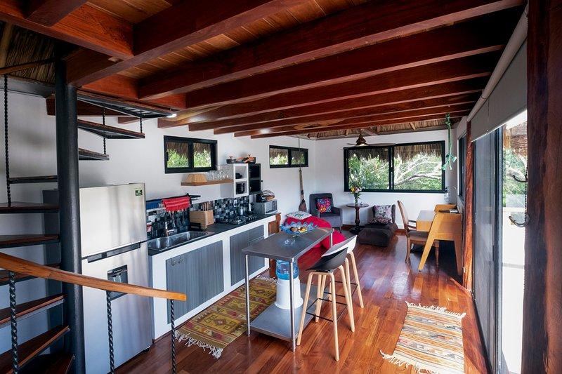 Open-plan vacation palapa apartment with hardwood flooring just outside Akumal