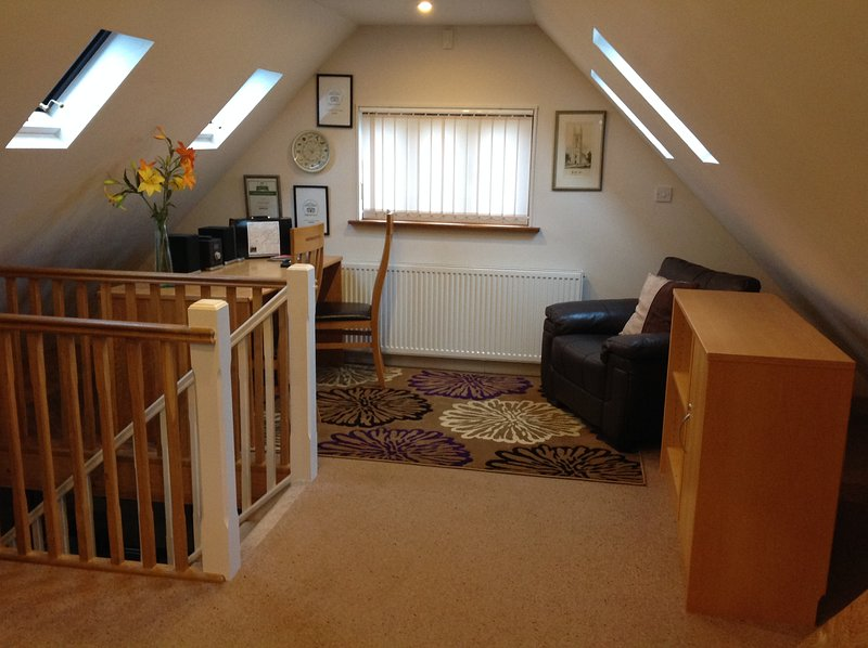 The upstairs study area is perfect for keeping in touch with the office while away on holiday.