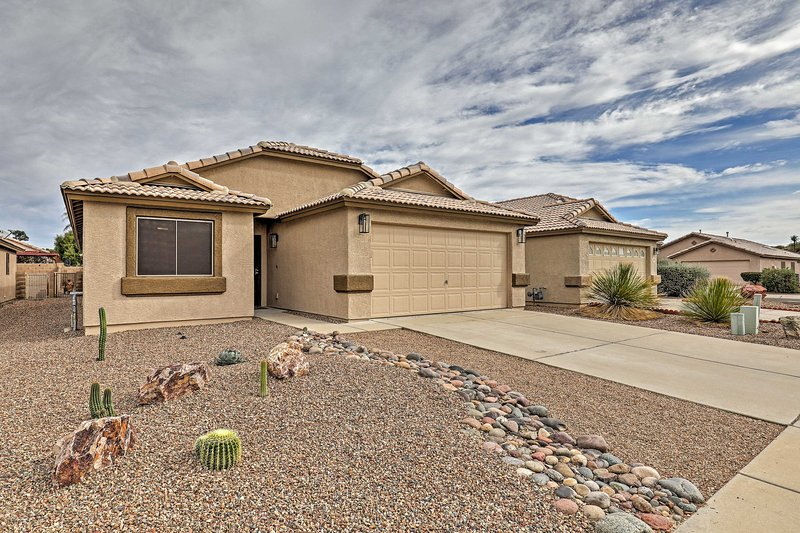 This 3-bed, 2-bath, stucco house is the perfect home base for your Tucson vacay!