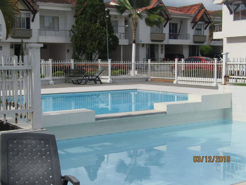 Large and small pool for adults, with tanning chairs and chairs for rest