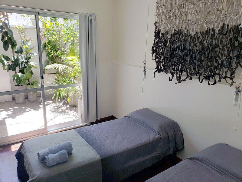 Simple beds with access to the patio. Laundry included. Fan and air conditioning.