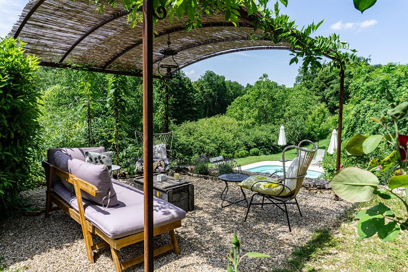 Kick up your heels, grab a glass of wine and relax under the wisteria overlooking thee pool.
