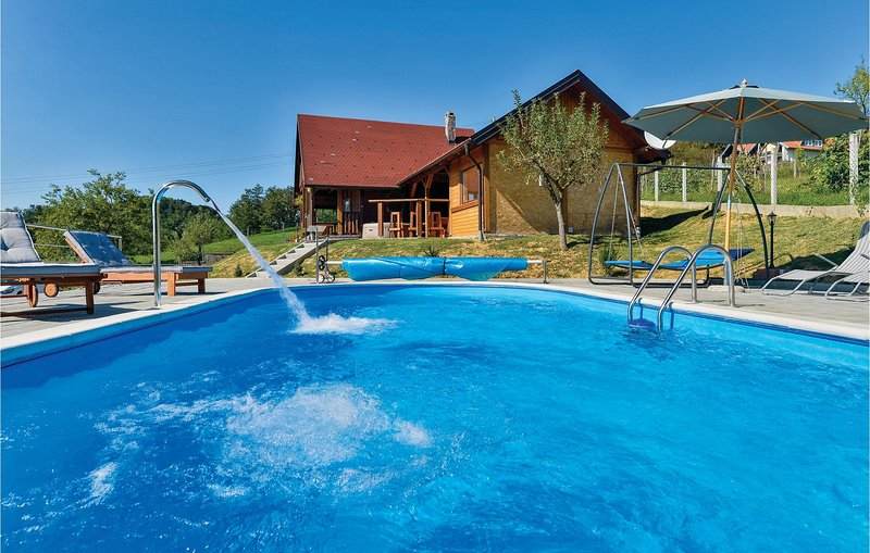 Nice home in Radakovo with Sauna, WiFi and Outdoor swimming pool (CCC147), holiday rental in Brestanica