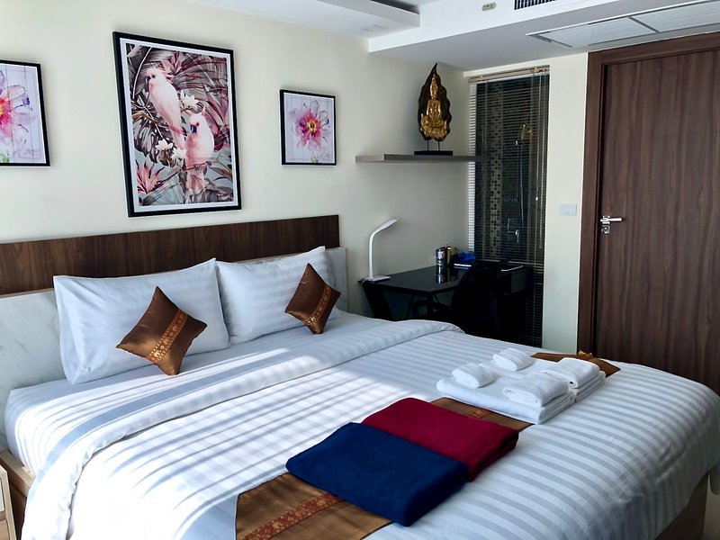 Bedroom with King Size Bed, Luxury Mattress, Desk and comfortable office chair.