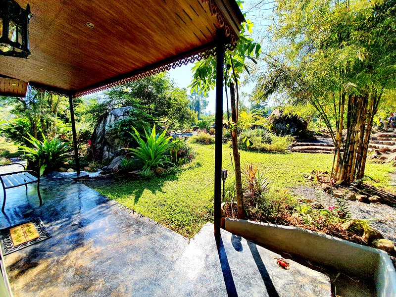 Private patio surrounding with boulders.
