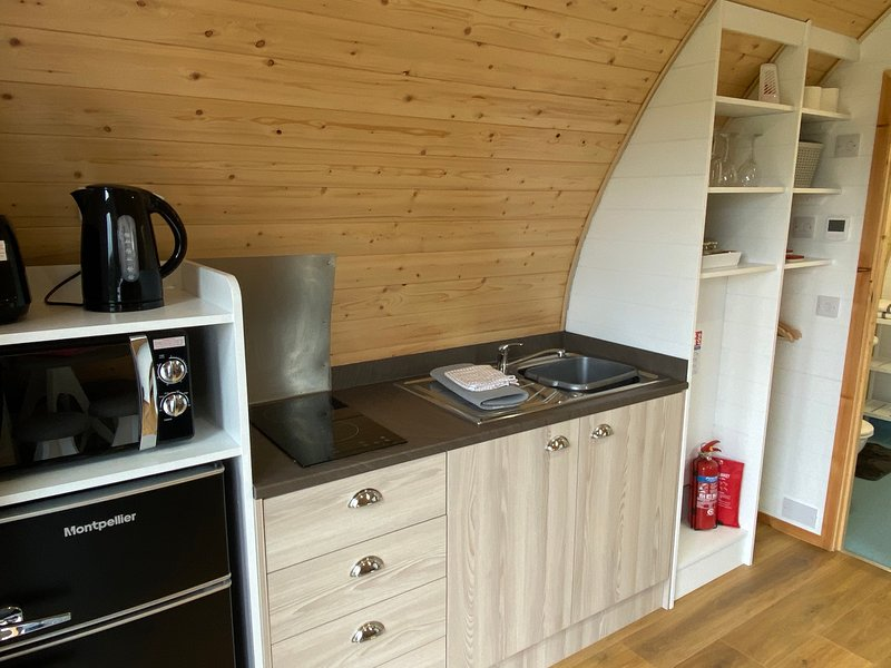 Kitchenette area, with kettle, toaster, fridge freezer, microwave and 2 ring hob