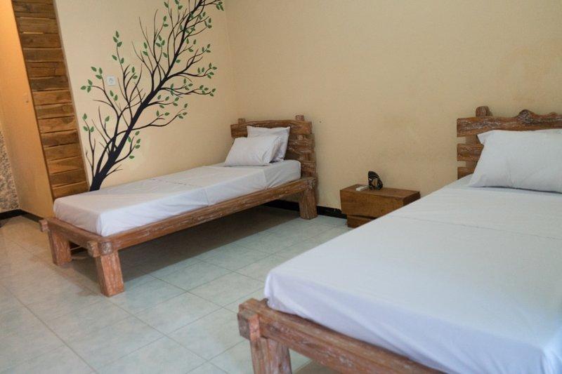 Turtle Room Sunrise Lodge and Lounge Twin Beds w/ Garden View, alquiler vacacional en Sambangan