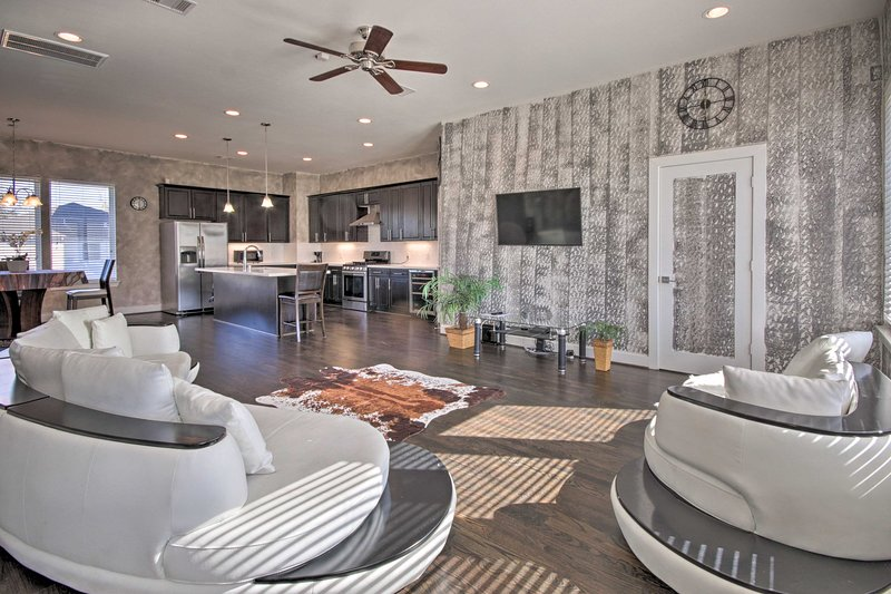 Get away to the Lone Star State and stay at this stunning 3-BR, 3.5-BA townhome!