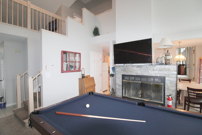 Second unit pool table with wood burning fireplace and large flat screen tv