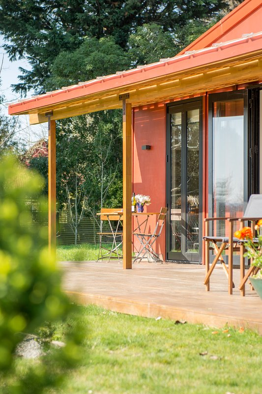Enjoy breakfast or a glass of local wine in the evening sun on the sunny deck