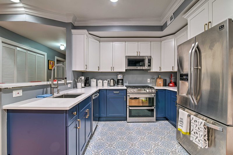 The vacation rental's vibrant kitchen is ready for cooking!