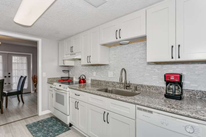 Renovated kitchen boasts new cabinets and granite counter tops