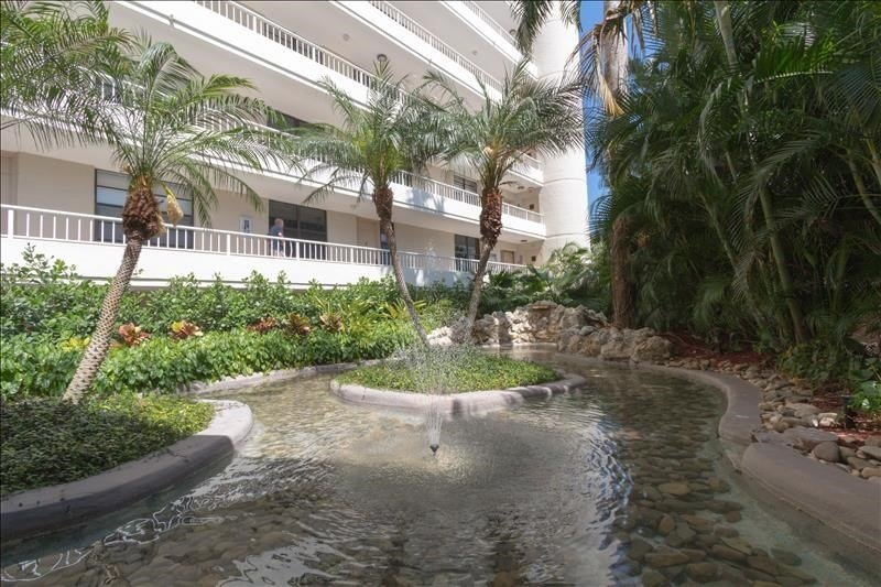 Water,Outdoors,Vegetation,Building,Palm Tree