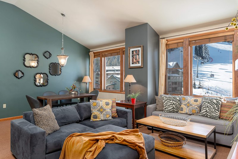 Ski area views from the open and plush living room with gas fireplace, flat screen TV and more