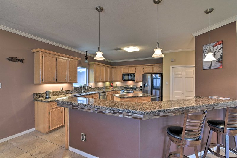 Try out a new recipe in the fully equipped kitchen complete with top appliances.
