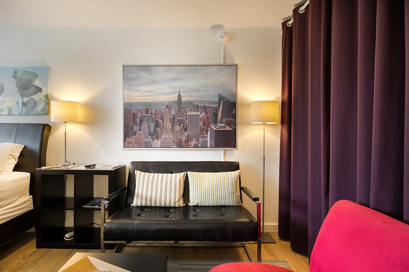 Cozy Sitting Area - Furnished Apartments Midtown Atlanta - Chic Premium Studios On 25th