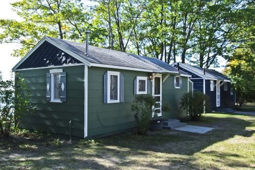Cabin #1 - Cedar Village, holiday rental in Carp Lake