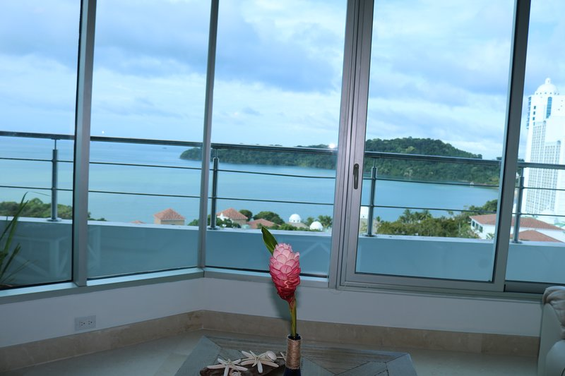View from living area with private balcony.