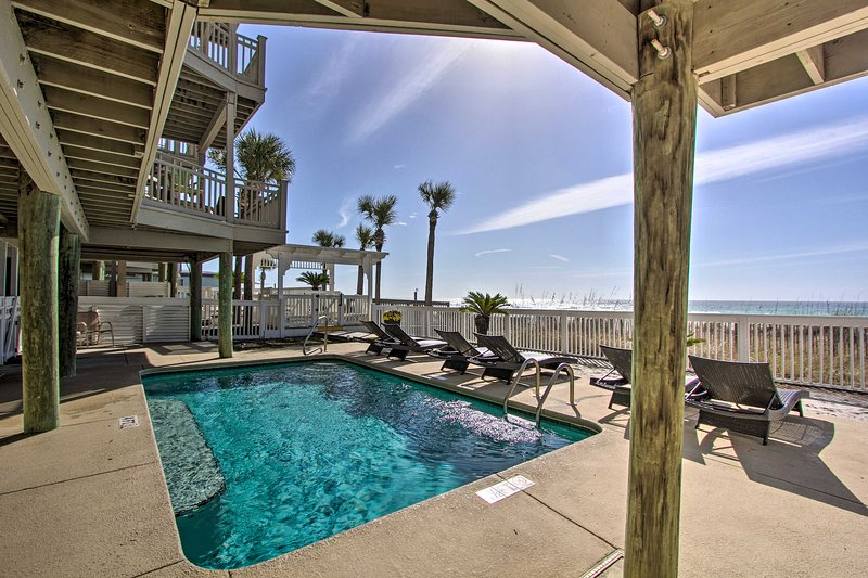 The vacation rental condo has access to a pool and private beach.