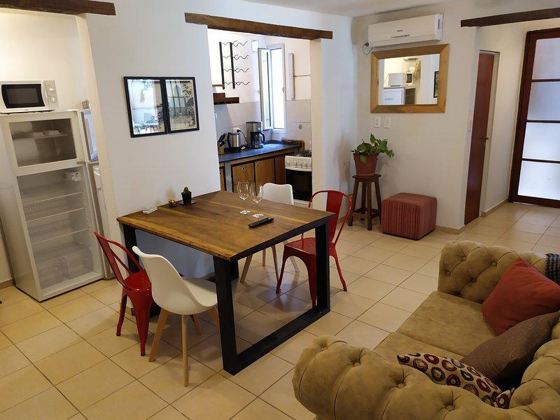Sala de estar con aire acondicionado y calefacción