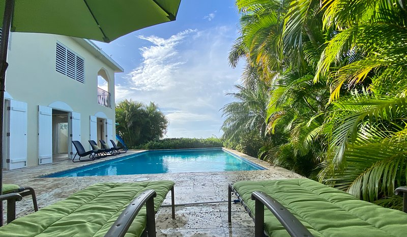 Tropical setting with stunning pool and views