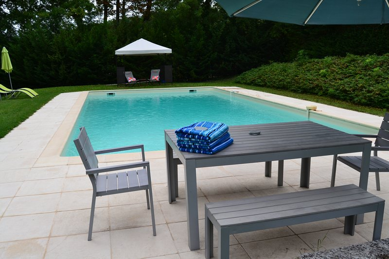 Large swimming pool with plenty of space to relax in the sun or shade. Pool towels provided.