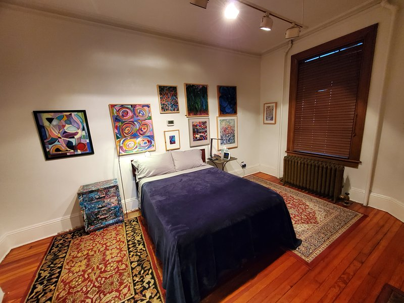 Massive Main Bedroom of GSG Inn with all original artworks by Jamie Brant and George Pissarro.
