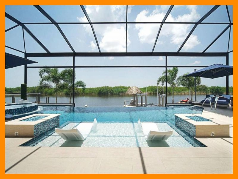 Cape Coral 300 - Immaculate luxury villa with infinity-edge pool and boat dock, holiday rental in Matlacha