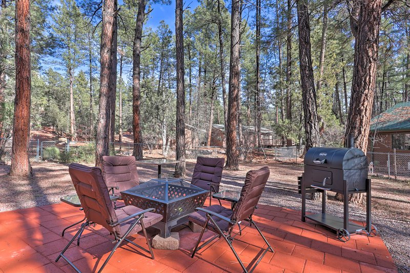This Pine home has a spacious backyard with seating and a fire pit.
