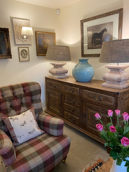 Lovely antiques and furnishings plus gorgeous paintings throughout the cottage.