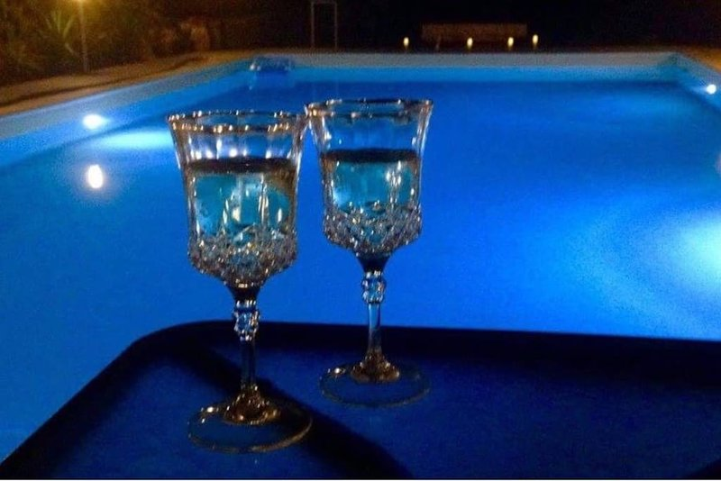 An evening drink by the pool