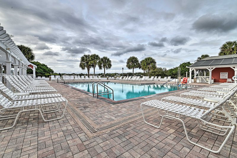 Spend days relaxing poolside at this vacation rental.
