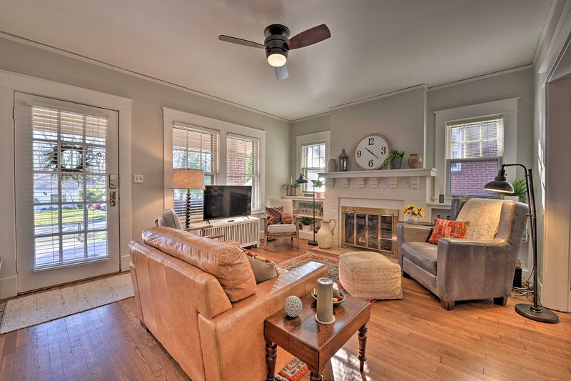 This bohemian Greensboro home has vintage hardwood floors and new furnishings!