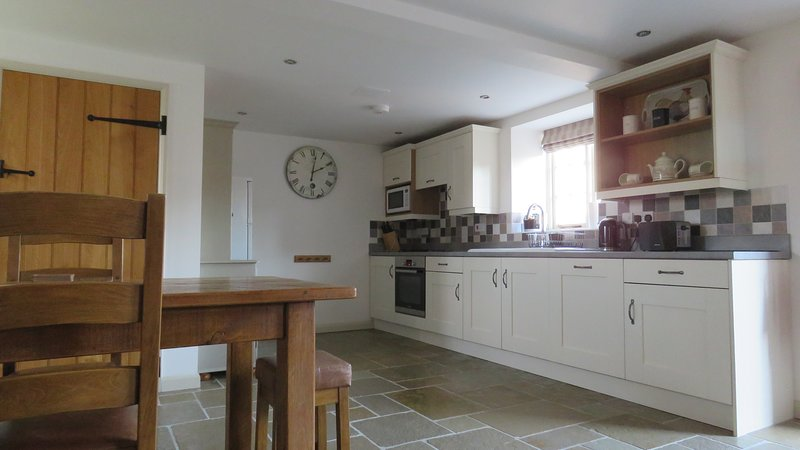 Kitchen with dishwasher, microwave, oven and hob