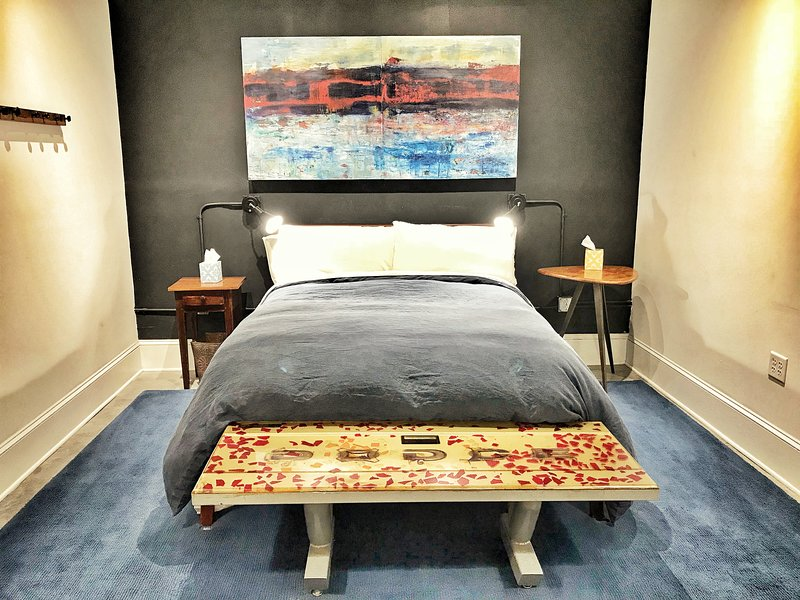 Queen Bed with down comforter and linen sheets.
