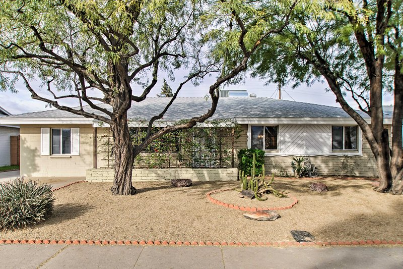 Mature trees provide shade to the front of this 4-bedroom, 2-bathroom home.