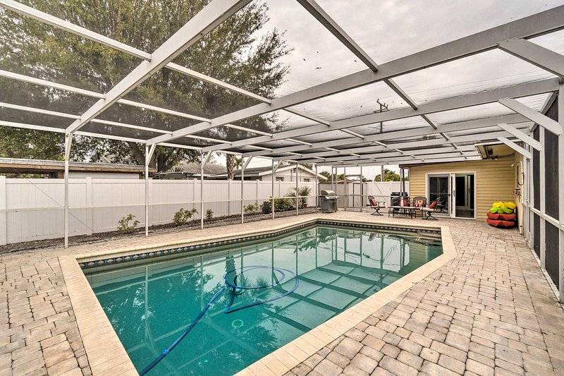 The home boasts a screened-in lanai with a barbecue space and pool.