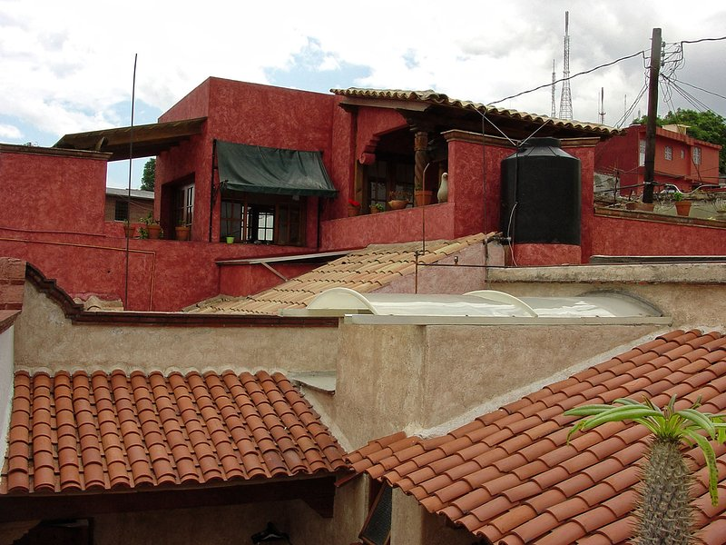 East view with red home that was also part of the original property, now belongs to Xochitl's sister