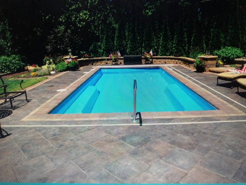 Model photo of  new pool for 2020.  Patio will vary.