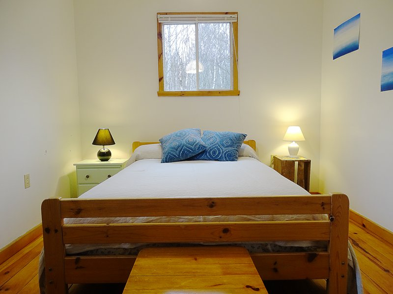 The second bedroom is cozy and airy.