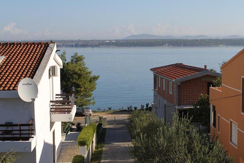 Tkon Apartment Sleeps 6 - 5809995, vacation rental in Zizanj Island