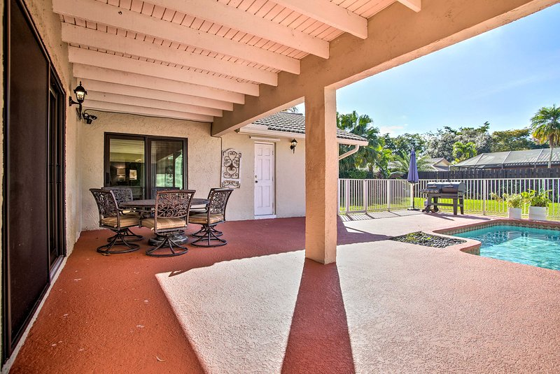 Step onto the patio for endless R&R at this Coral Springs home!
