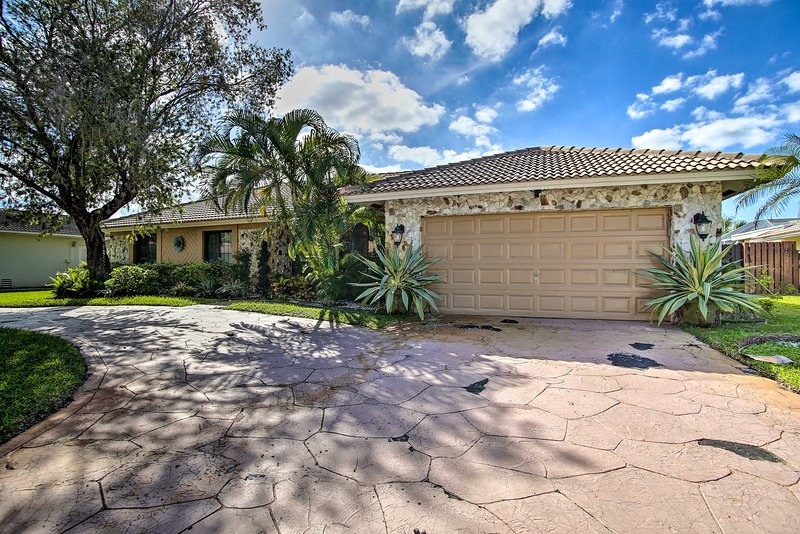 Lush tropics welcome you to this Coral Springs vacation rental!