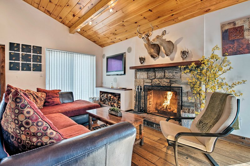 Relax in the living room to warm up in front of the wood-burning fireplace.