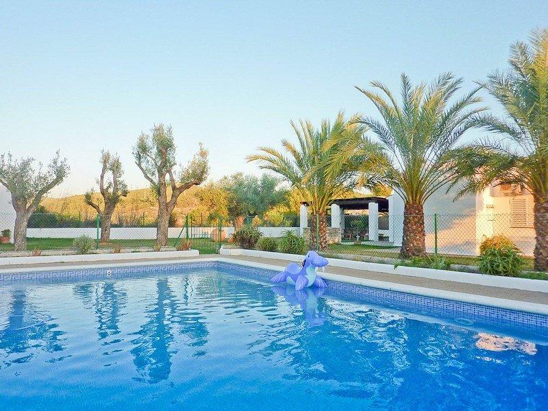 Villa con piscina en Santa Gertrudi, alquiler vacacional en Santa Gertrudis