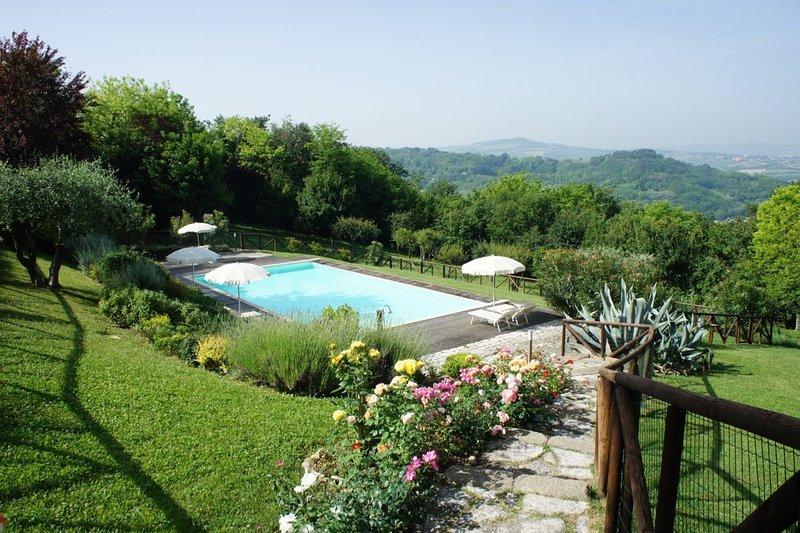1- Casesanbartolo - appartamento tri-locale Viole - nel parco  - vicino al mare, vacation rental in Peglio