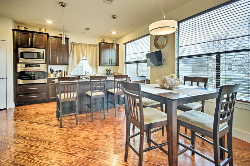 This townhome features large windows and a city view from the balcony!
