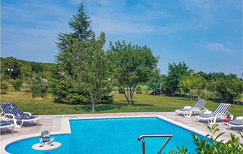 Nice home in Labin with Outdoor swimming pool, WiFi and 2 Bedrooms (CIO276), holiday rental in Rasa