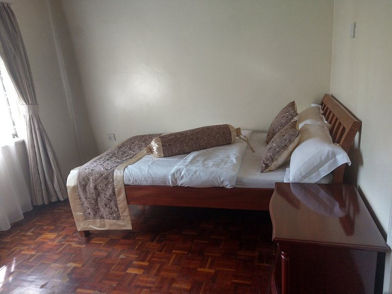 Birds of Paradise Holiday Homes - Bedroom 1, alquiler vacacional en Thika